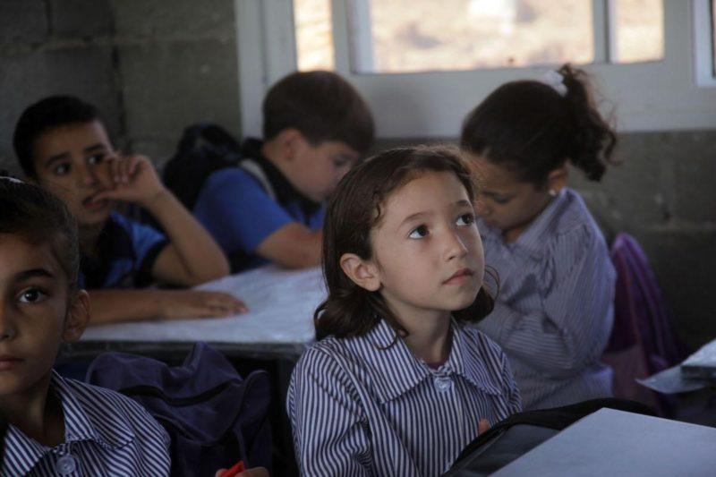 Anak-anak Palestina di sebuah sekolah di Tepi Barat pada 11 September 2018. Foto: Mamoun Wazwaz/Anadolu Agency
