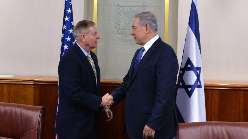 Senator AS Lindsey Graham (kiri) dan gembong zionis Netanyahu (Kobi Gideon/GPO via Getty)